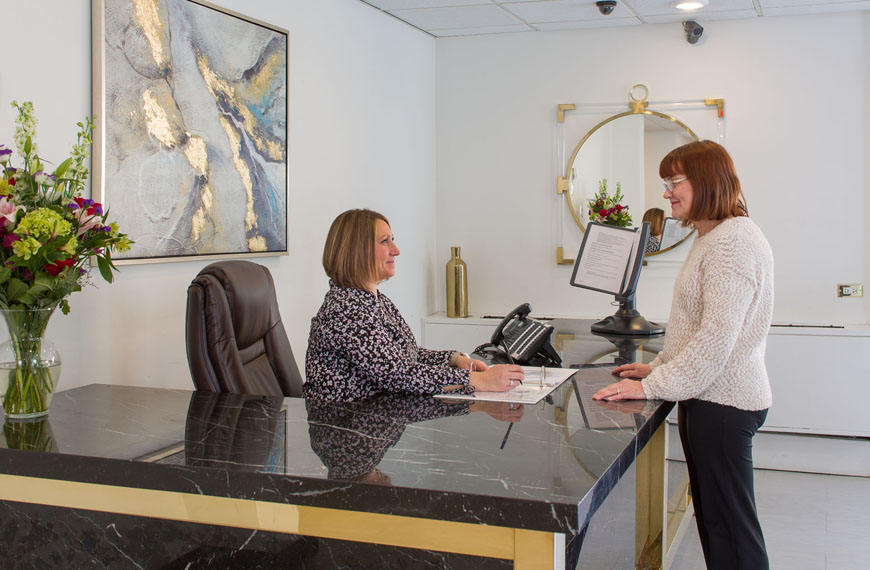 Lobby and reception desk at Surge